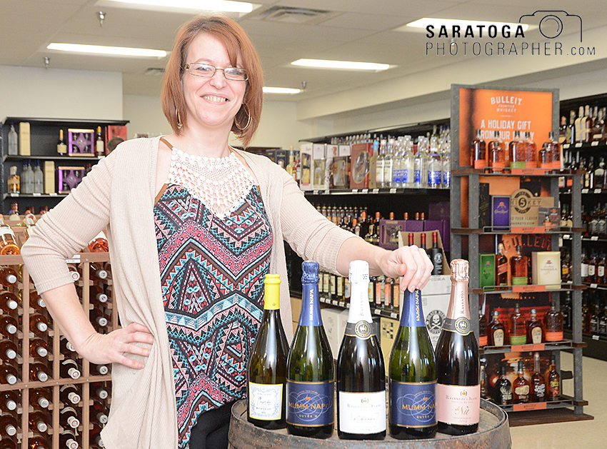 Shelley Colvin, manager of Halfmoon Wine and Liquor, displays some of the product availablle at the store, which opened in November in the Crescent Commons on Route 9. ©2016 Saratoga Photographer.com