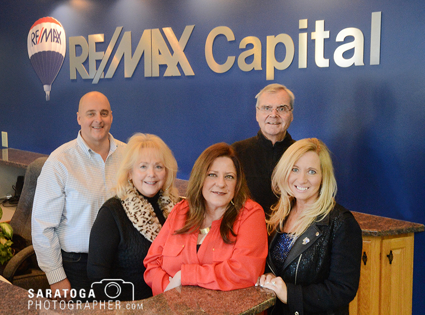 The staff of the RE/MAX Capital's newest office in Clifton Park poses in the lobby. The company says the 3,000-square-foot office brings the RE/MAX brand to a growing community. ©2017 Saratoga Photographer.com