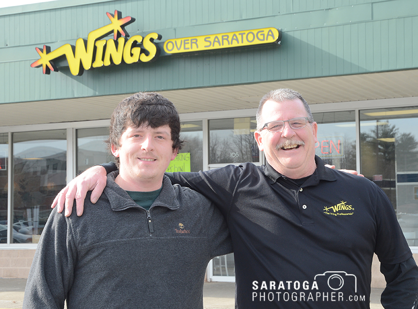 Joe Hill, right, and his son, Tanner, are owners of this store, Wings Over Saratoga, located at 103 West Ave. in Saratoga Springs. They serve a variety of foods for take-out or delivery. ©2017 Saratoga Photographer.com