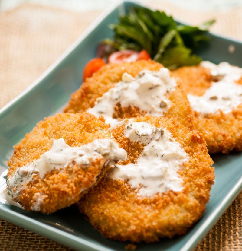 fried green tomatoes with white sauce on top