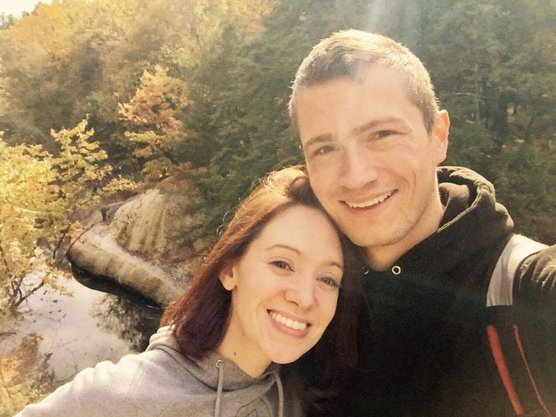 man and woman selfie on bridge overlooking orenda tufa at saratoga spa state park