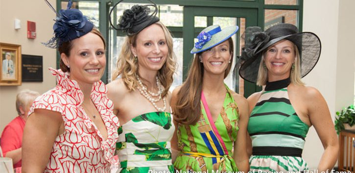 four women at a derby day party