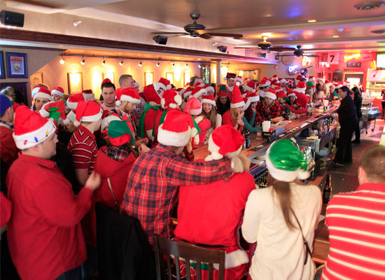 large group of people celebrating santacon in saratoga