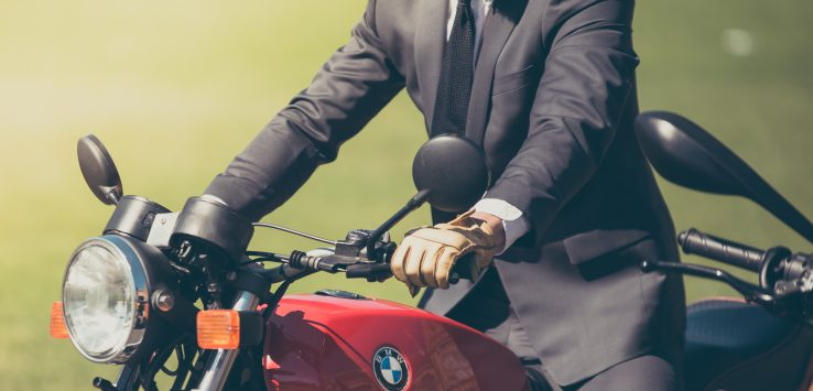 man in suit on motorcycle ride