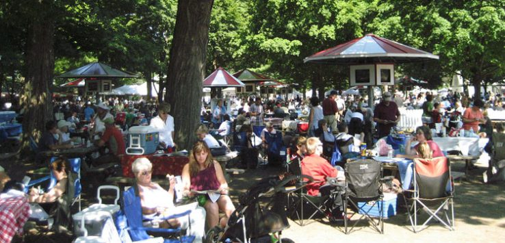 a crowd at race track picnic area