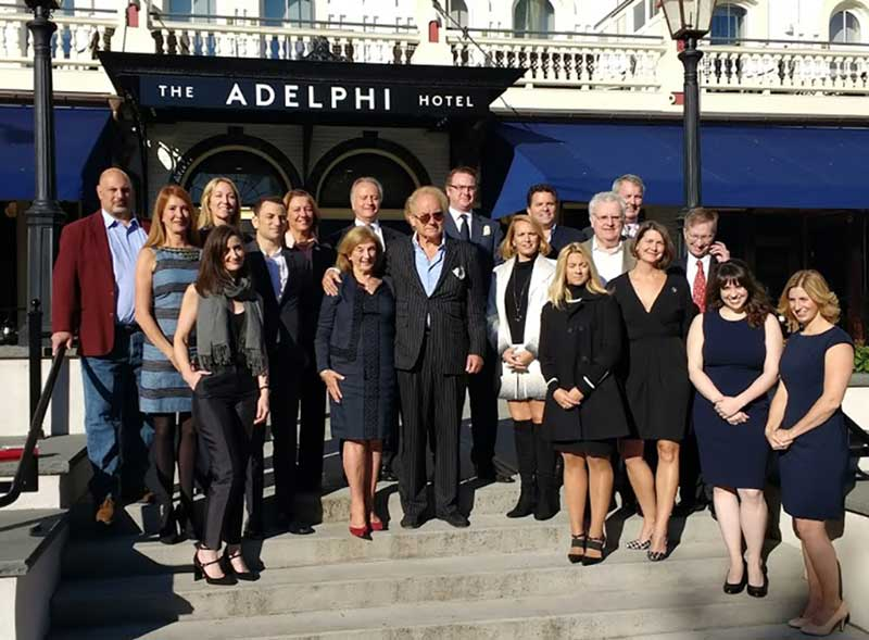 Toby Milde, Adelphi staff, and local officials gathered in front of The Adelphi Hotel
