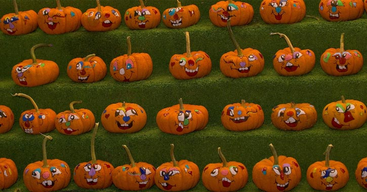 small pumpkins with painted faces
