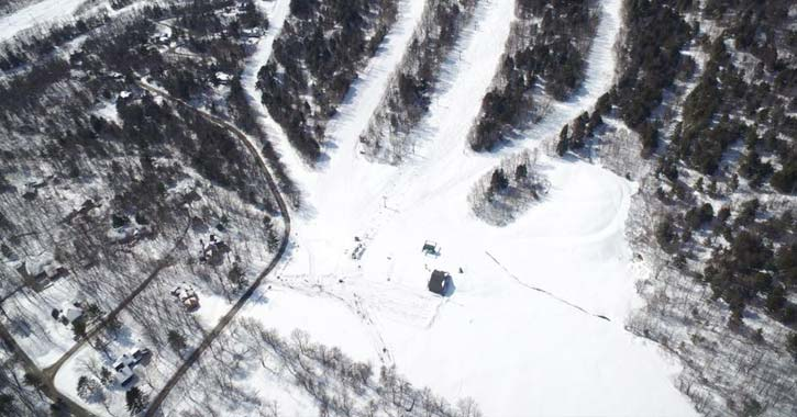 view of a ski lodge from above in winter