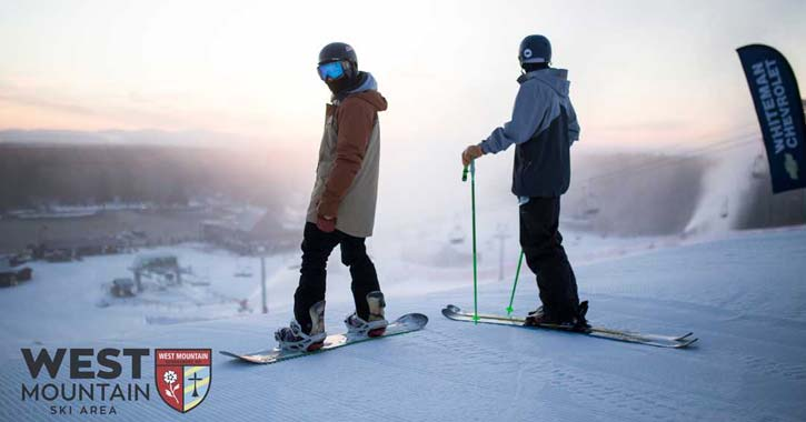two skiers on a slope