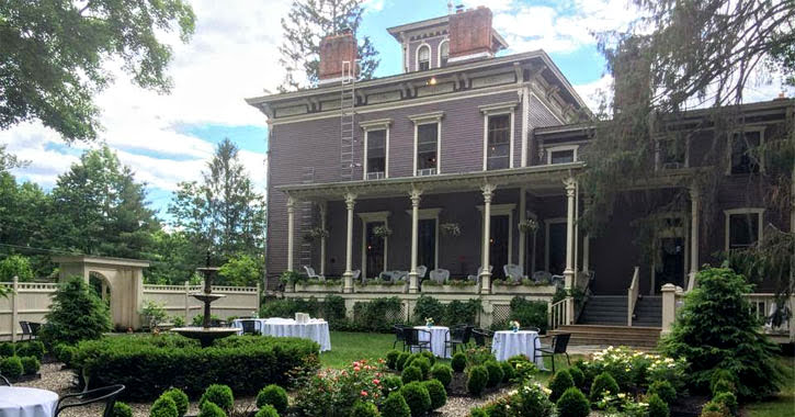 the outside of The Mansion Inn on a nice spring day