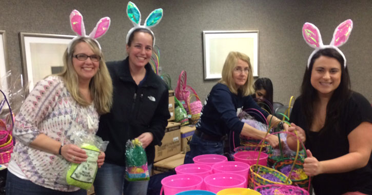 people in Easter attire assembling baskets