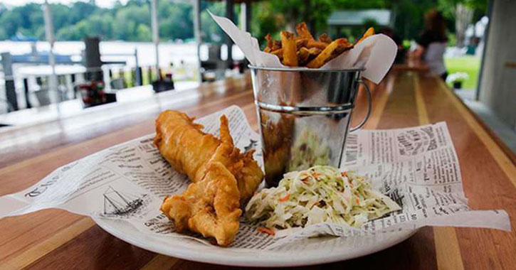 fish fry dish in the foreground, view of lake and patio in the background