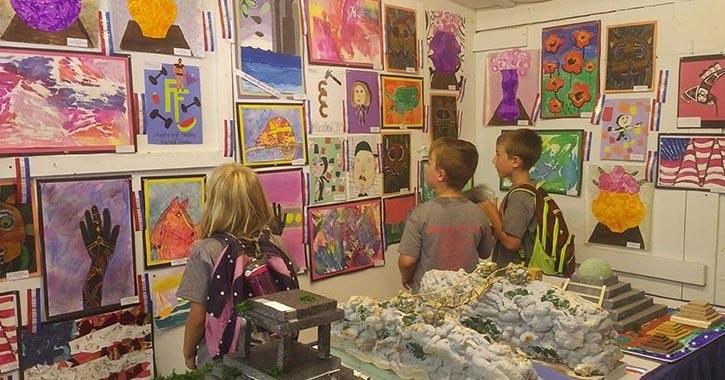kids looking at artworks