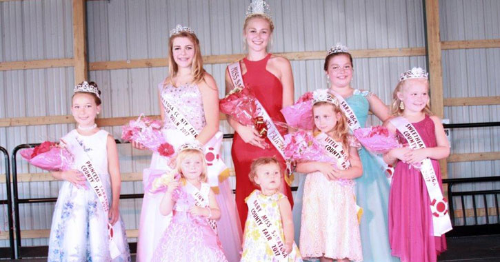 young women and girls on stage after winning at pageant