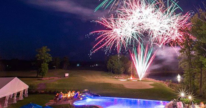 fireworks over golf course pond