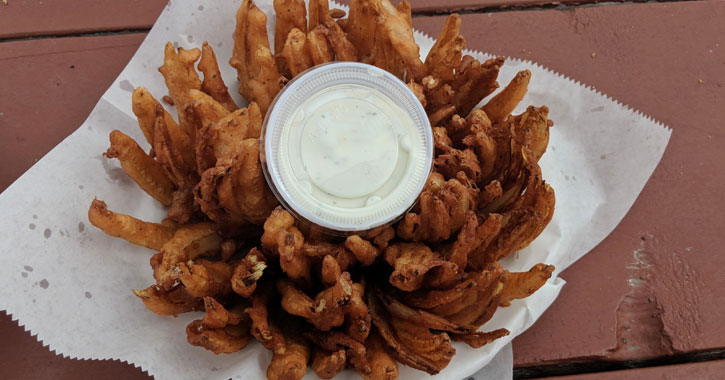 a bloomin' onion with Ranch dipping sauce in the middle