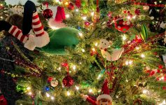 close up of a decorated Christmas tree, elf diving into it