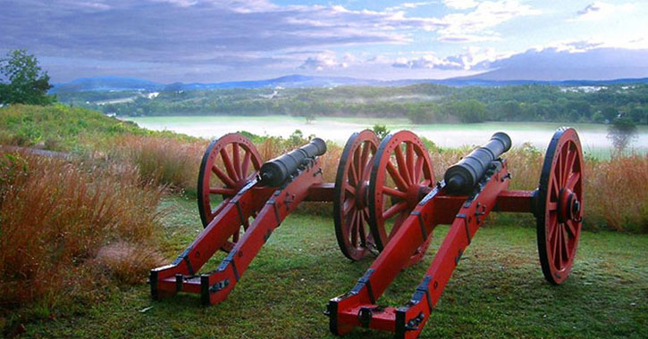 two cannons facing the water