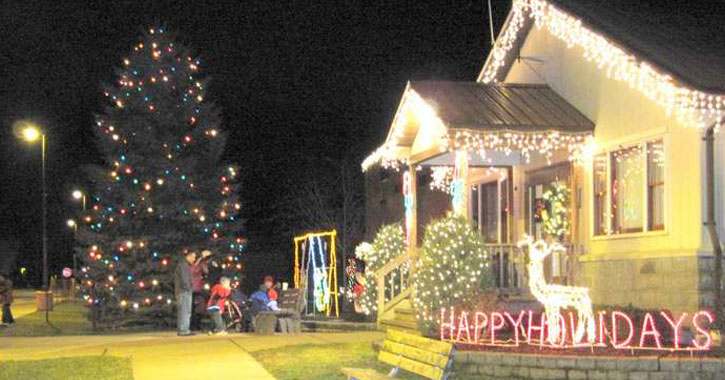 tree lighting by a house