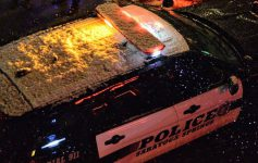 a Saratoga Springs police car, it's snowing