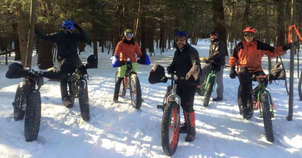 people on fat bikes on snow