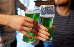 cheers with green beer in glasses