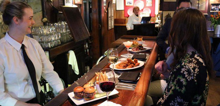 people eating at a bar