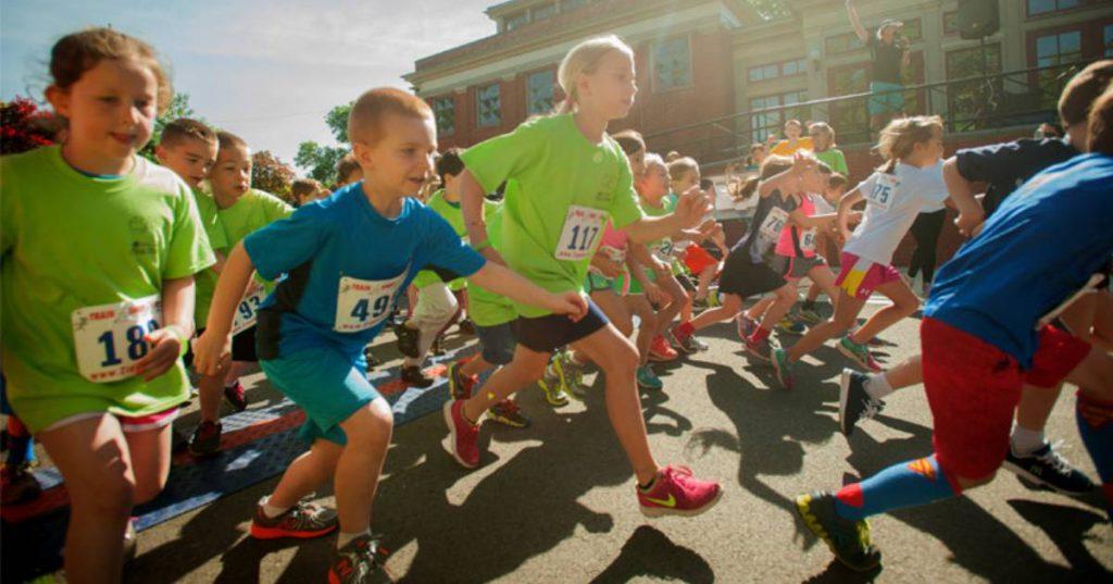 kids running down road in race