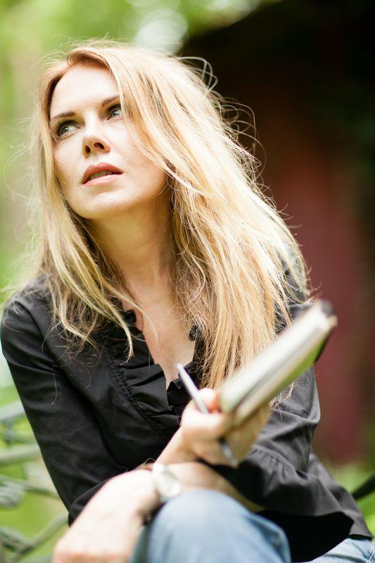 blonde girl looking pensive