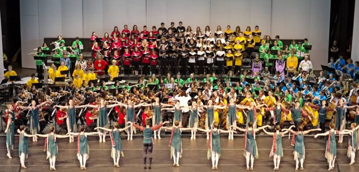 large group of dancers on stage