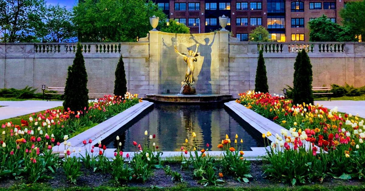 statue and tulips in park