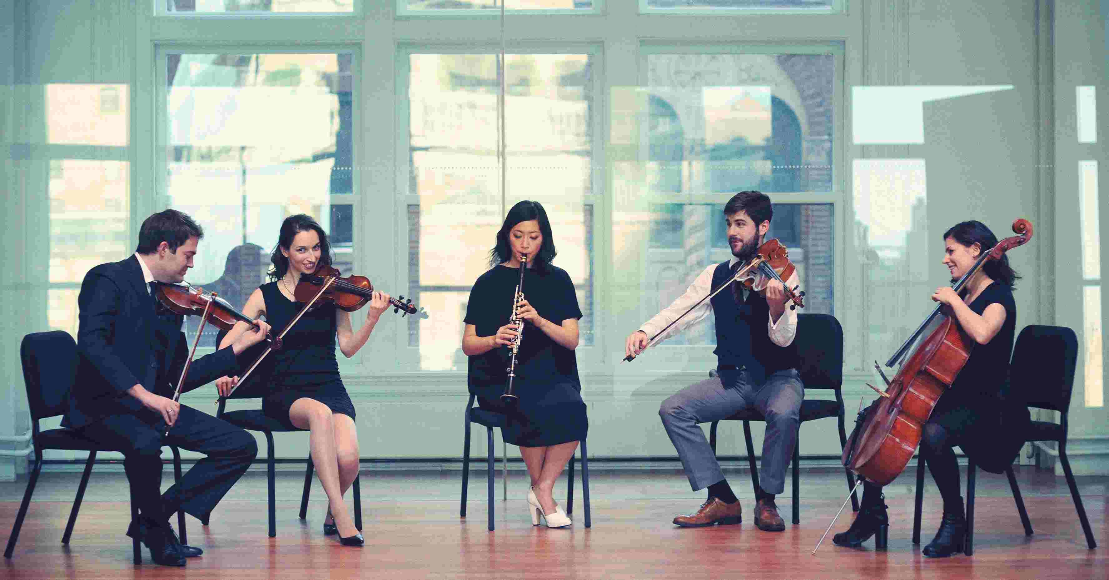 the Decoda chamber music collective plays their instruments in a concert hall