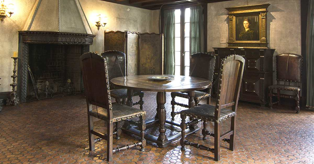 an antique dining table sits in the middle of the hyde dining room