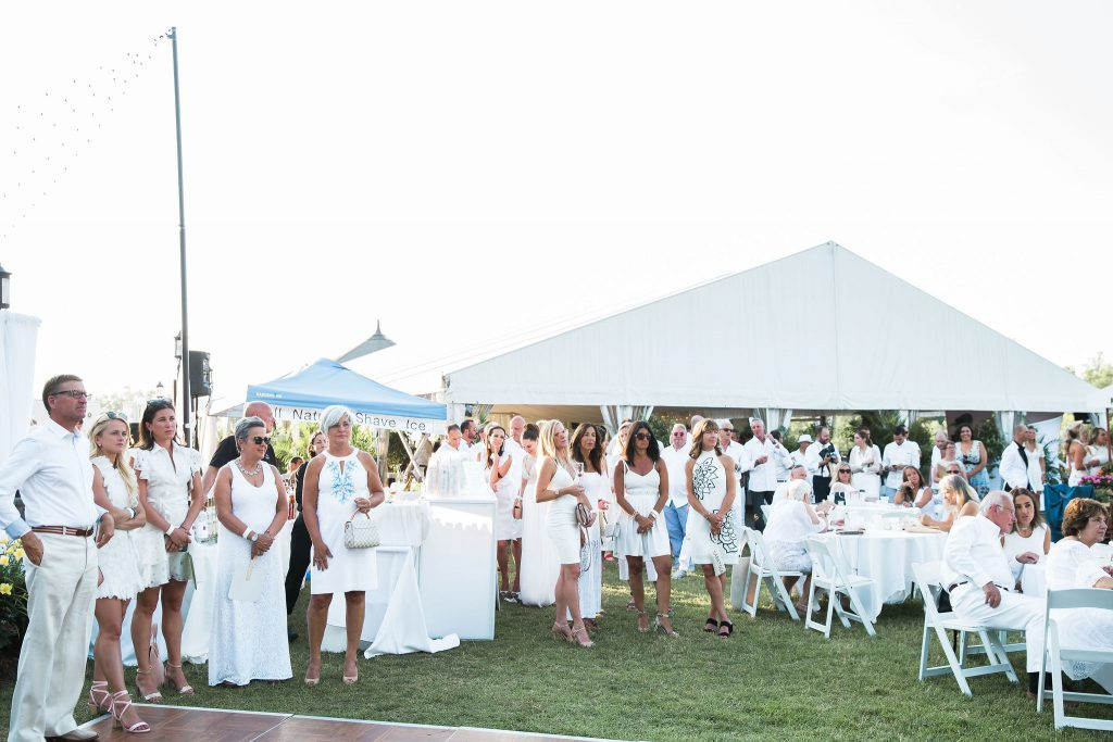 a shot of the crowd at the white party