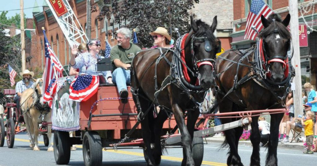 horse drawn wagon in a parade