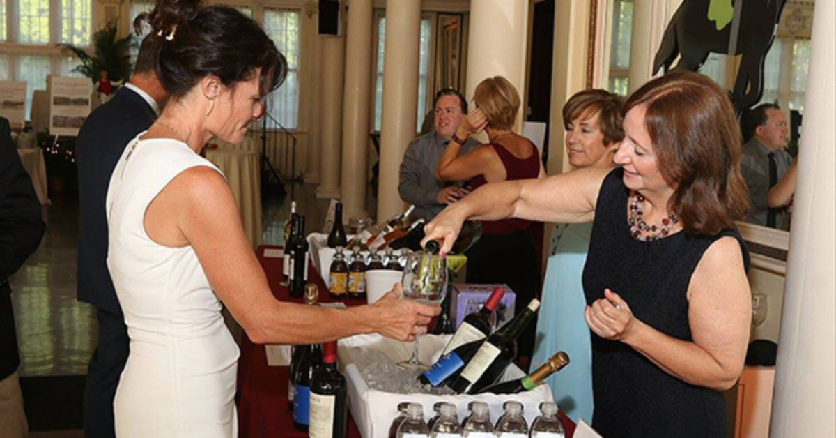 a guest being poured wine at the travers wine tasting