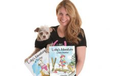 author with her dog and dog books