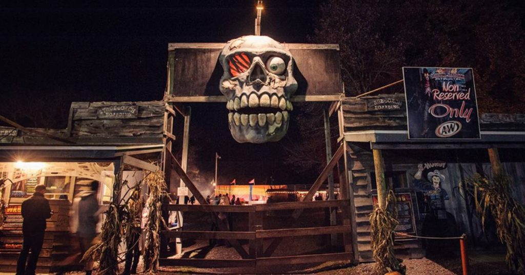 giant skull at entrance of attraction
