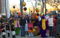 people standing together at a fall festival