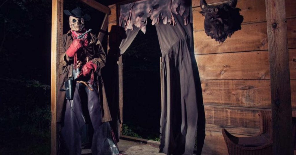 spooky skeleton figure at haunted attraction