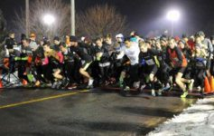 runners leaving the starting line of the first night 5k