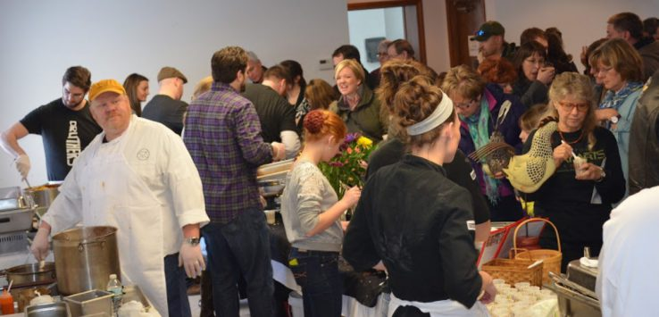 people at an indoor food tasting event