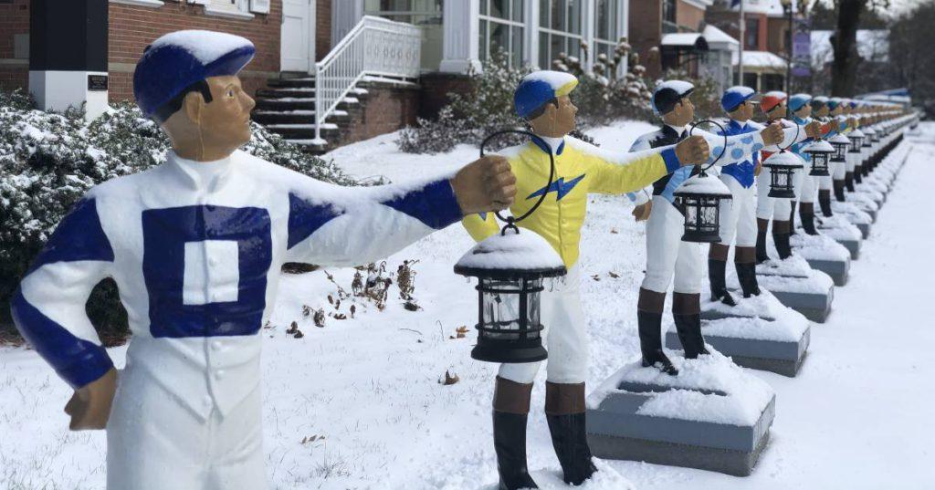 jockey statues in a row