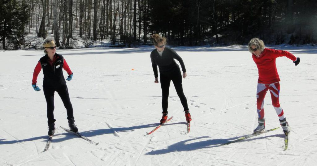 three women cross country skiing
