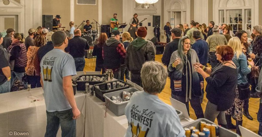 people at an indoor brewfest