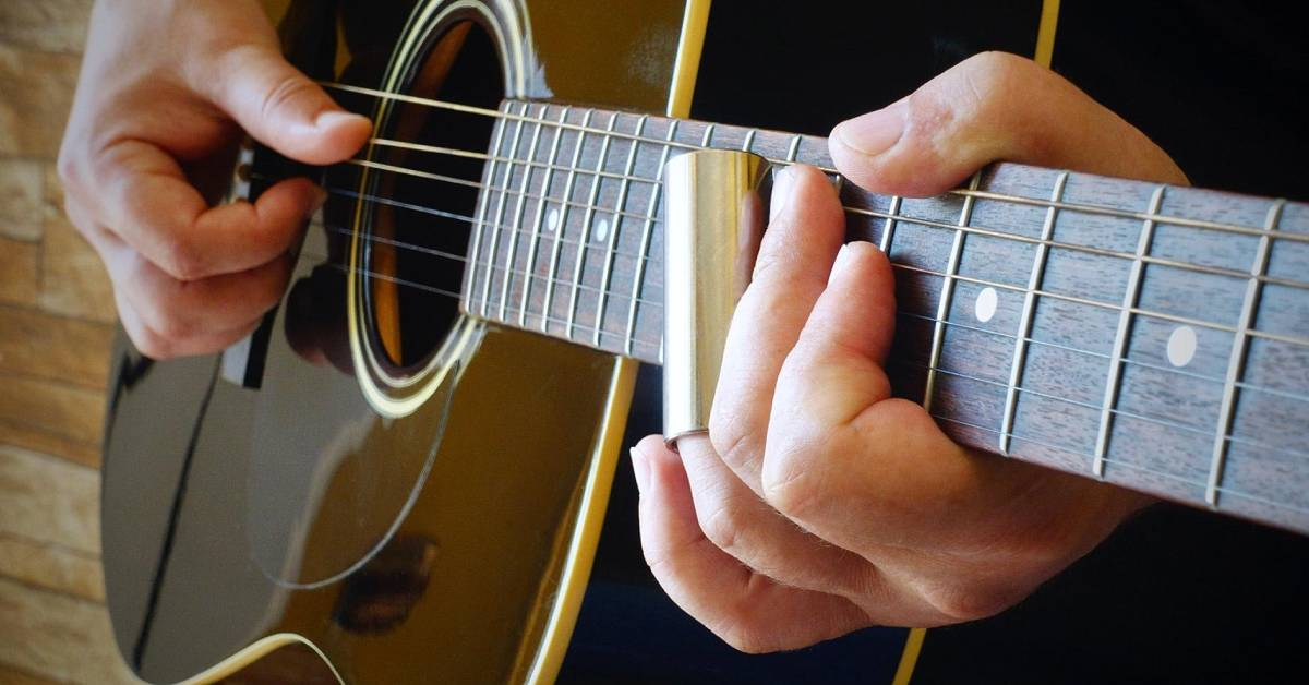 person holding an acoustic guitar