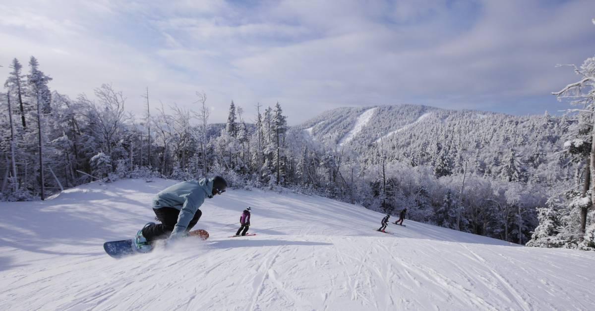 snowboarder going down mountain
