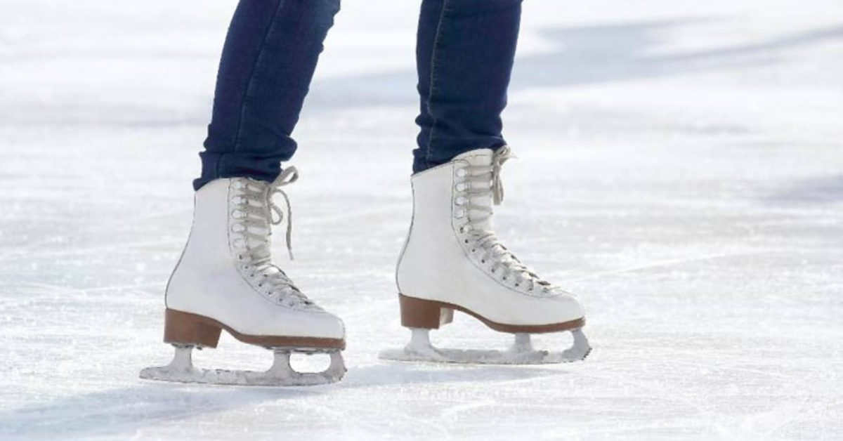 person wearing jeans and white ice skates