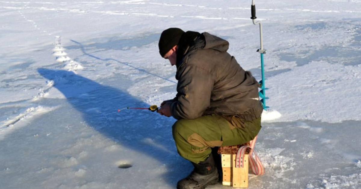 a man ice fishing