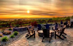 spacious patio with sun setting in the back